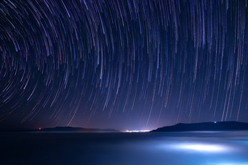 The Stars night of startails with fog at Khao Takhian Ngo View Point at Khao-kho Phetchabun,Thailand