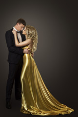 Fashion Couple Beauty Portrait, Kissing Man and Woman, Well Dressed in Golden Dress and Black Suit