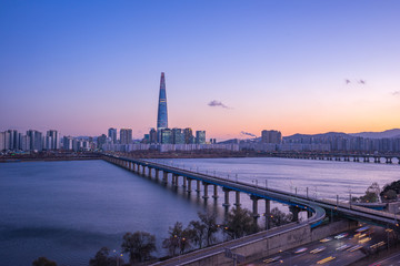 Han River at twilight with view of Seoul city skyline in South Korea
