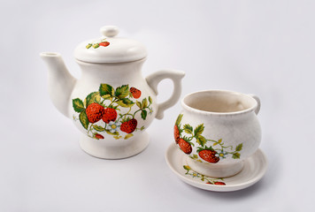 Strawberry Tea Service stock images. Teapot with mug on a white background. Ceramic Strawberry Decor
