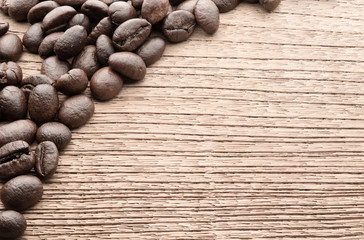 Pile of coffee bean on wooden background