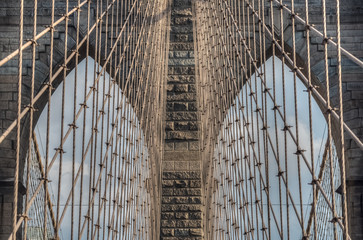 Detail of the Brooklyn Bridge neo-Gothic arches and steel suspension cables, civil engineering masterpiece, New York City