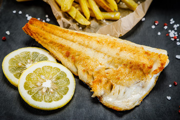 Fish dish - fried fish fillet french fries and vegetables