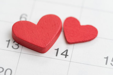 Lovely Red heart wooden shapes on day 14 on calender using as Valentines day reminder