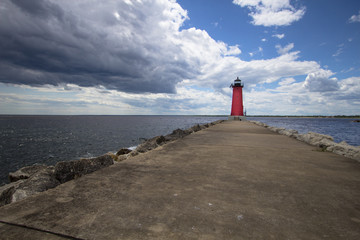 Summer Lighthouse Background. Manistique Michigan Lighthouse under a beautiful blue summer sky. Upper Peninsula, Michigan, USA.