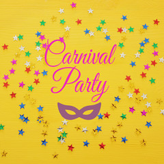 Carnival party background with colorful confetti. Top view.