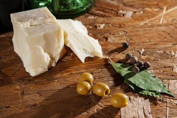 cheese and olives on wooden surface