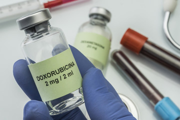 Doctor subject vial with doxorubicin, medication used for disease of leukemia linfatica acute, image conceptual