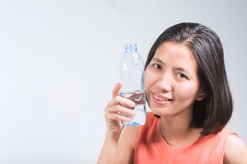 Beautiful Asian women and Bottled water