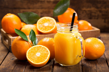 Deurstickers Sap glass jar of fresh orange juice with fresh fruits