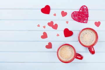 Two cup of coffee and mixed hearts on pastel blue table top view. Morning breakfast for Valentines day. Love concept.