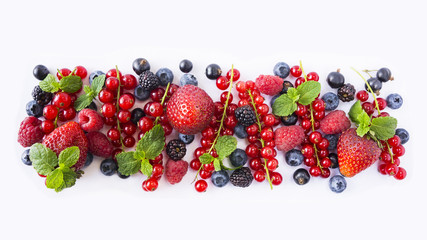 Black-blue and red fruits. Ripe red currants, strawberries, raspberries, blackberries, blueberries and blackcurrants on white background. Berries with copy space for text.