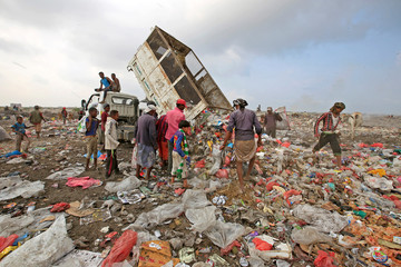 People search for recyclables in a garbage dump on the outskirts of the Red Sea port city of Hodeida