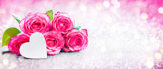 Romantic background with bouquet of pink roses and heart