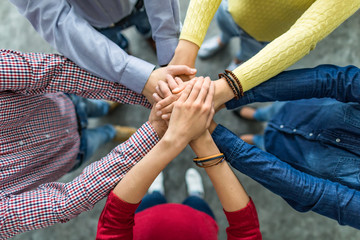 Stack of hands. Unity and teamwork concept.