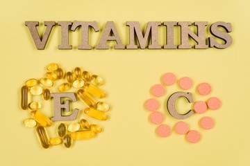Vitamins And Supplements. Vitamin C, E. fish oil capsules and vitamin C vials