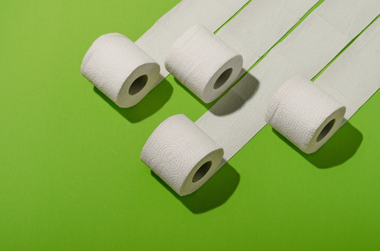 Toilet paper concept on green background. Hygiene and health. Concept photo.