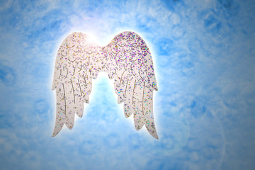 Wings on blue background stock images. Angel wings christmas decorations
