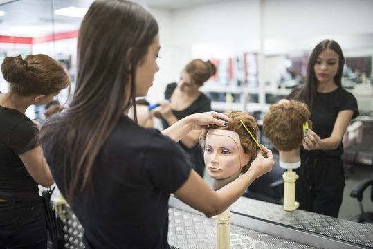 Hairdressers with little girls, men, women and training
