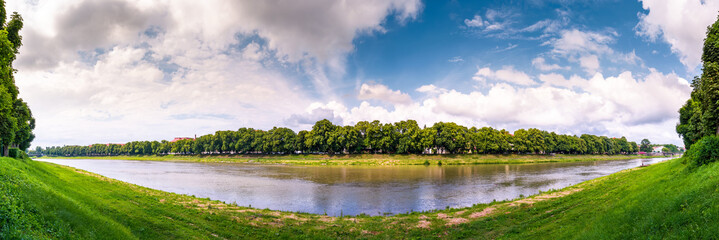 panorama of longest linden alley in europe. Summer landscape on the river embankment in Uzhgorod, Ukraine.