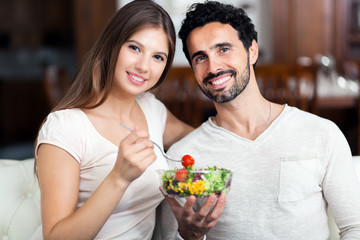 Couple enjoying a healthy salad together