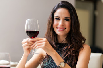 Woman holding a glass of ed wine