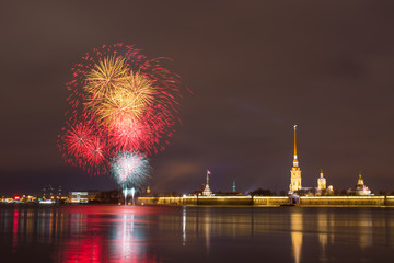 Firework on the Neva River near the Peter and Paul Fortress at night in the city of Saint-Petersburg.