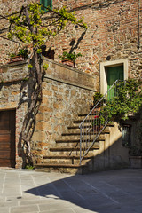 stairs with old vinegar in old city in Italy