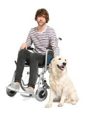 Young man in wheelchair with his dog on white background