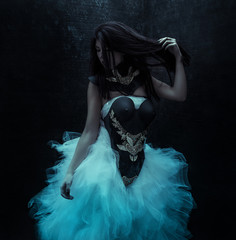 luxury, brunette woman dressed in Gothic style with a lush tulle dress and corset with pieces of jewelry