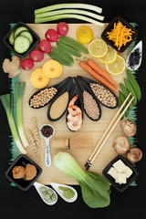 Japanese macrobiotic diet food background including seafood, tofu, wasabi and miso paste, grains, legumes, vegetables and tea with foods high in protein, antioxidants, fiber, vitamins and minerals.
