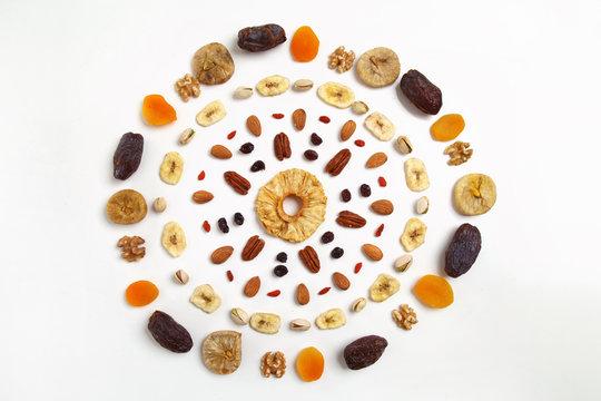 mandala of dried fruits and nuts - symbols of jewish holiday Tu Bishvat