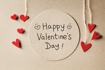 Happy Valentines Day message with handmade small paper hearts