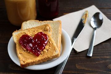 Peanut butter and heart shaped jelly sandwich