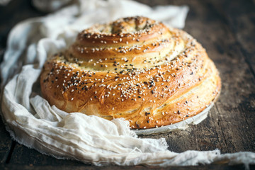 Homemade and baked bread with yellow and black sesame served on the wooden table,selective focus