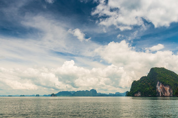 beautiful sky with cumulus clouds over the picturesque mountains in the Andaman Sea, Thailand