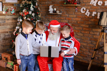 Funny boys friends prevent Santa Claus from ordering gifts on l