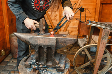 blacksmith working with hot metal at fair
