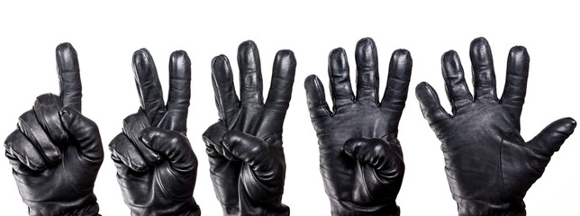 Set of five hands in black leather glove showing numbers isolated on white. Wall mural