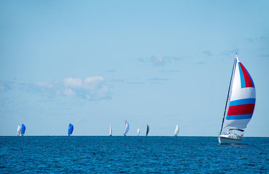sailboats with spinnakers in boating race on Lake Michigan
