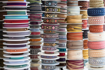 Grosgrain and another type of ribbons in a haberdashery.