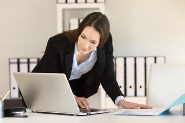 Businesswoman working comparing documents online