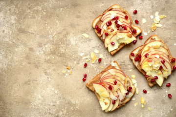 Toasts with peanut butter and apple slices.Top view with copy space.