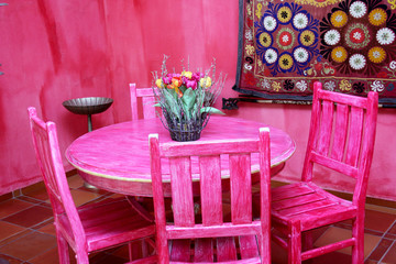 Colourful Moroccan tables and chairs.
