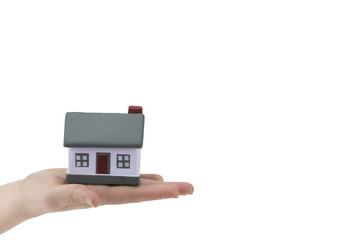 building, mortgage, real estate and property concept - close up of hands hold house model.with copy space