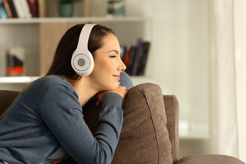 Woman relaxing listening to music and looking away