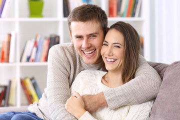 Happy couple with perfect smile looking at you