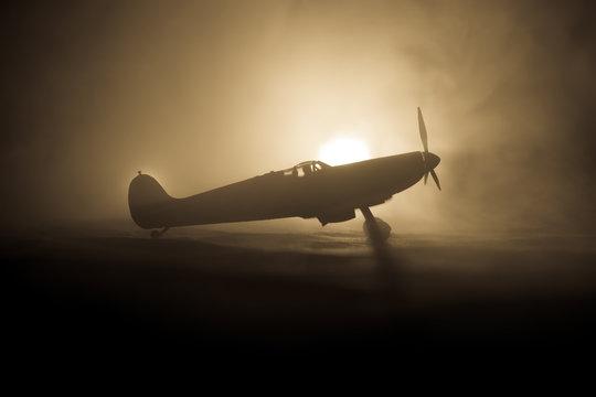 British jet-propelled model plane in possession. Dark orange fire background. War scene.
