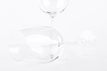 Cropped image of empty wine glass. Wine glass over white background.