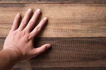 adult asian man hand on wooden table background